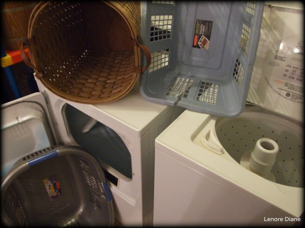 Empty Laundry Baskets and Empy Washer and Dryer